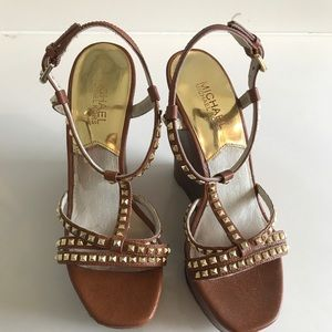 Michael Kors Shoes - Michael Kors size 8M brown and gold wedges.